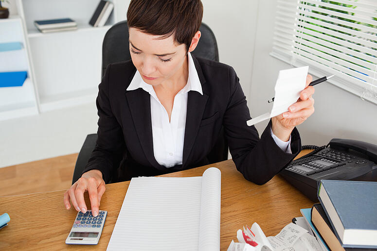 Active accountant checking receipts in her office