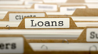 Loans Concept. Word on Folder Register of Card Index. Selective Focus.