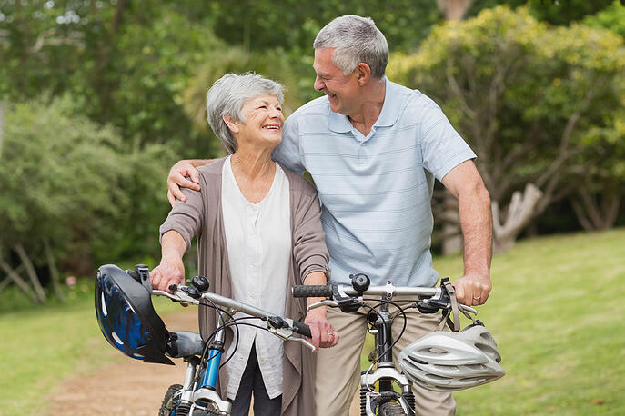 Portrait of a senior couple on cycle ride at the park