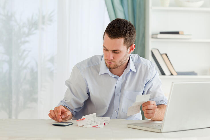 Young businessman calculating