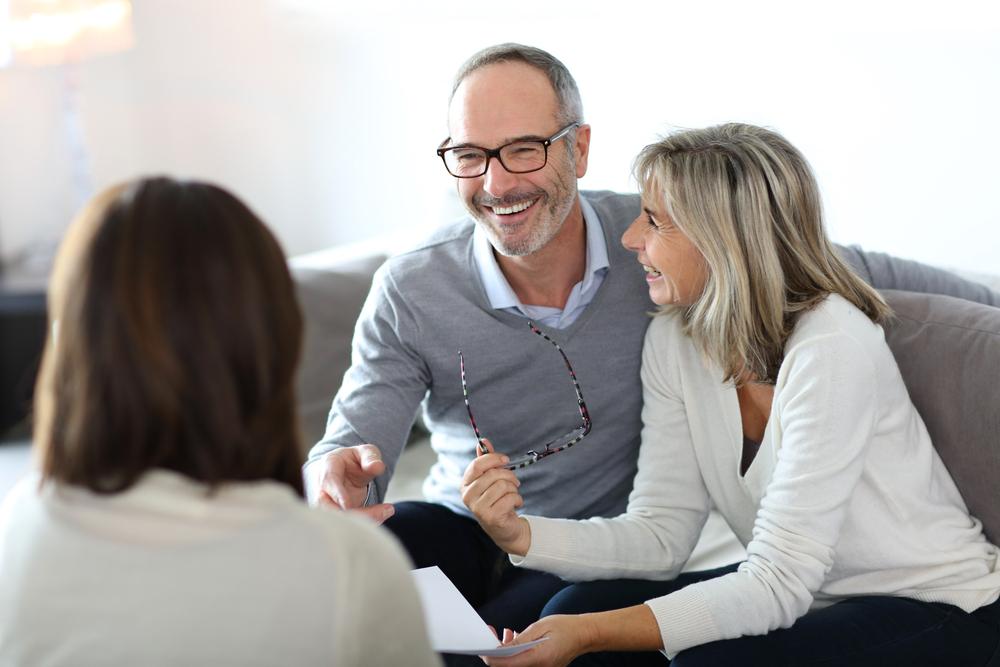 Senior couple meeting financial adviser for investment-1