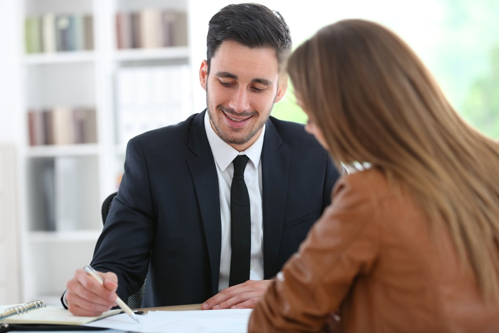 Woman meeting financial adviser in office-1